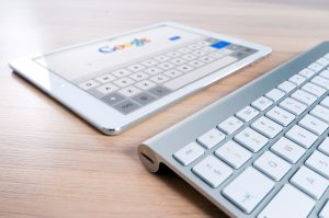 tablet and external keyboard used to search Google