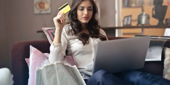 girl holding CardValet debit card
