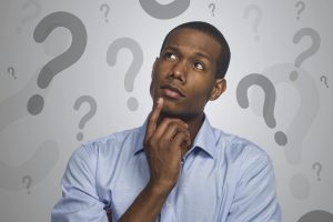 man thinking with question marks around head